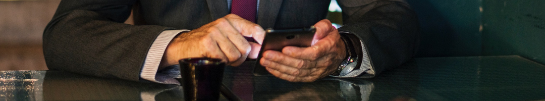 man reading technology news on phone